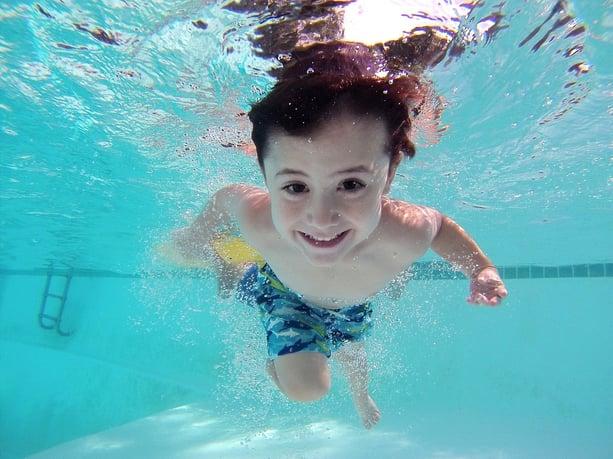 family-friendly-central-florida-neighborhoods-orlando-suburbs-bellalago-child-swimming.jpg